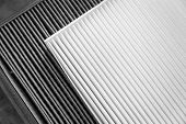 Close Up, Clean And Dirty Cabin Air Filter For Car. Car Air Filter Texture And Background poster