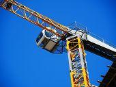 Crane. Self-erection Crane. Tower Crane Against Blue Sky. Construction Site. poster