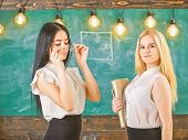 Ladies Ready To Start Private Lesson, Chalkboard On Background. Attractive Teachers Overworking Afte poster