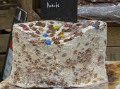 A Large Piece Of Nougat With Migdalem Packed In Cellophane poster