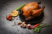 Roasted Chicken / Baked Whole Chicken Grilled With On Herbs And Spices And Dark Background poster