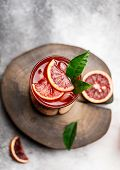 Blood Orange Juice With Ice And Orange Slice. Fresh Summer Cocktail With Red Oranges In A Glass. Fre poster