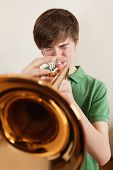 Teen Playing Gold Trumpet