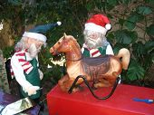 picture of  midget elves  - this is a pair of elves fixing a rocking horse for the kids - JPG