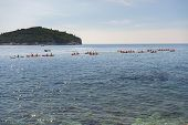 Young People Are Floating In A Sea Kayaks. Water-based Activities In Dubrovnik Bay, Adriatic Sea. Ac poster
