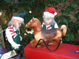 image of  midget elves  - this is a pair of elves fixing a rocking horse for the kids - JPG
