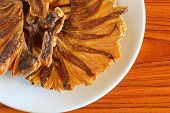 stock photo of skat  - Dried fish fried On  the brown wood - JPG