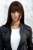 pic of straight jacket  - Glamorous young woman in black leather jacket on white background - JPG