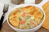 pic of biscuits gravy  - Chicken pot pie meal with carrots and peas - JPG