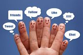 stock photo of bubbles  - Social network concept finger people in discussion with speech bubbles - JPG