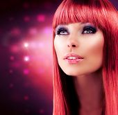 Beauty Red Haired Model Portrait. Beautiful Girl with Long Healthy Hair. Stylish Glamour Woman. Make