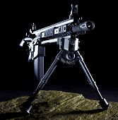 stock photo of ar-15  - Semi automatic rifle that is set up with a bipod in the dark on a rock - JPG