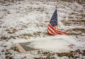 Veteran's Grave In A Rural American Cemetery In Winter