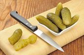 Pickled Gherkins On A Wooden Chopping Board