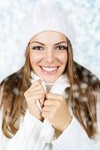 Smiling beautiful woman with white hat and scarf
