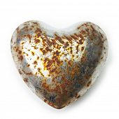 Rusted heart. Rusted and bruised chrome heart isolated on white.