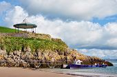 View of boat and bandstand at Castle Beach, Tenby.