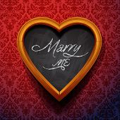 Marry Me written by chalk on heart shaped board