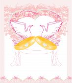 foto of ring-dove  - romantic card with love birds and golden wedding rings  - JPG