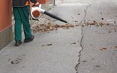 foto of sweeper  - Street sweeper collects leaves from the fan motor - JPG