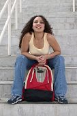 Happy Young Latina Student With Backpack On Stairs poster