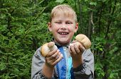 pic of face-fungus  - The joyful boy shows mushrooms which has found - JPG