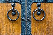 Closeup Of Wooden Door With Metal Door Handle.