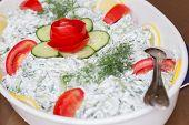 Greek salad made of vegetables and yogurt
