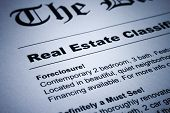 stock photo of residential home  - Closeup of real estate classified ads on newspaper - JPG