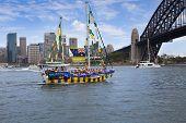 Decorated Yacht Sails Under Sydney Harbour Bridge On Australia Day