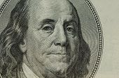 Portrait of Benjamin Franklin on a one hundred dollar bill
