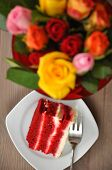 image of red velvet cake  - Red Velvet Cake with Roses in the background - JPG