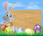 stock photo of peep  - Easter bunny rabbit and sign with chocolate painted Easter eggs - JPG