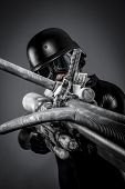 Tech.Starfighter with huge plasma rifle, fantasy concept, military helmet and goggles motorcyclist