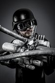 Starfighter with huge plasma rifle, fantasy concept, military helmet and goggles motorcyclist. airso
