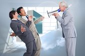 Senior salesman with megaphone yelling at his employees against room with holographic cloud