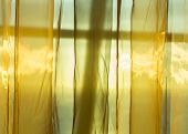 Golden Net Curtains Shield Sunshine Behind Window