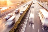 picture of smog  - Cars in motion blur on street during sunset - JPG