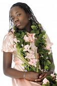 A flower bedecked tween girl appearing snooty as she looks down on the viewer.  On a white background.