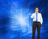 Thinking businessman touching chin against abstract blue squares