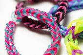 stock photo of rubber band  - A group of colorful rubber band bracelets - JPG