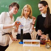 Girls Working In Chemistry Laboratory At The Classroom