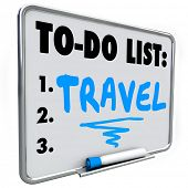 Travel word written on a dry erase board with blue marker as a priority or goal to reach in your lif