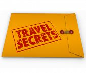 Travel Secrets words stamped on yellow confidential or classified envelope full of tips, advice and vacation transportation information