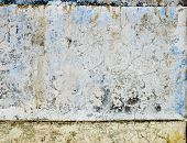 Worn Blue Paint Texture In Old Stone Wall.
