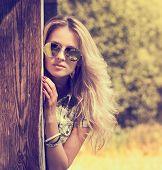 Trendy Hipster Girl on Summer Nature Background