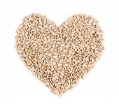 Heart shape of pelled sunflower seeds.