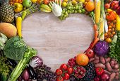 pic of vegetarian meal  - food photography of heart made from different fruits and vegetables on wooden table - JPG