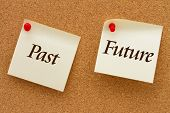 stock photo of past future  - Past versus Future Two yellow sticky notes on a cork board with the words Past and Future - JPG