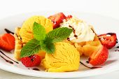 Belgian waffle with fresh strawberries and ice cream